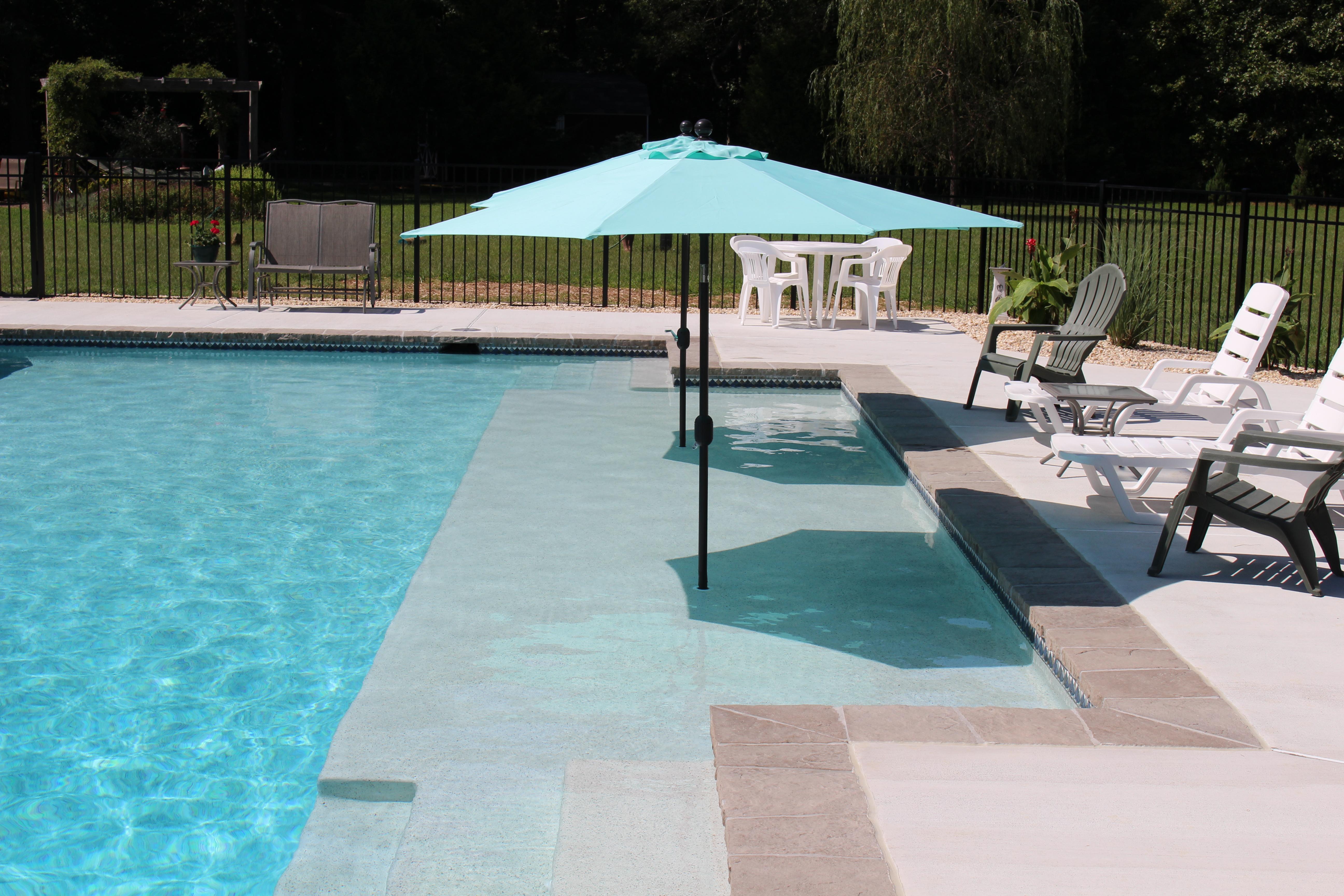 Swimming Pool With Sun Shelf The Pool Company Construction Pools Backyard Inground Pool Umbrellas Swimming Pools Backyard
