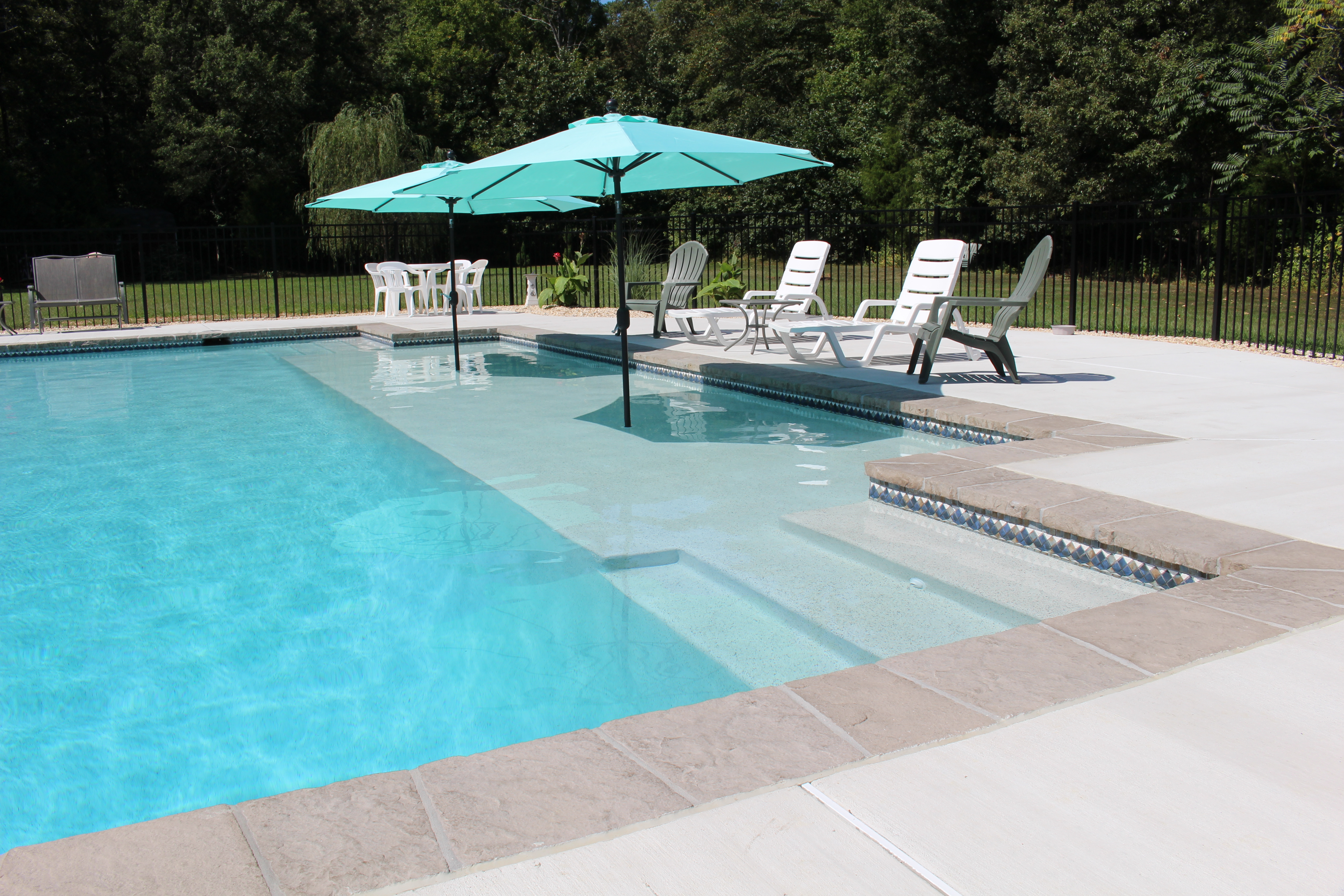 Swimming Pool With Sun Shelf The Pool Company Construction