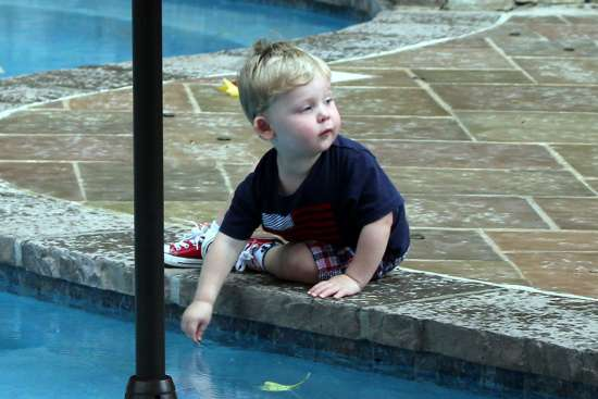 Swanson boy at poolside